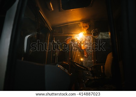 INDIA-GOA-14 october 2014 - Local car repair station. Worker is fixing the bus with the help of welding.