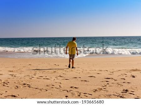 India. Kerala. The teenager on a beach - stock photo