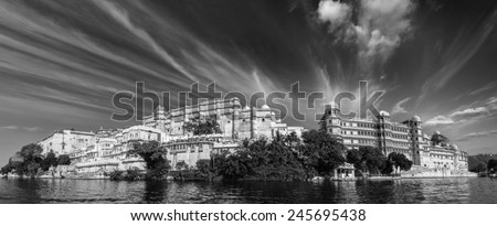 India luxury tourism concept background - panorama of Udaipur City Palace from Lake Pichola. Udaipur, India. Black and white version - stock photo