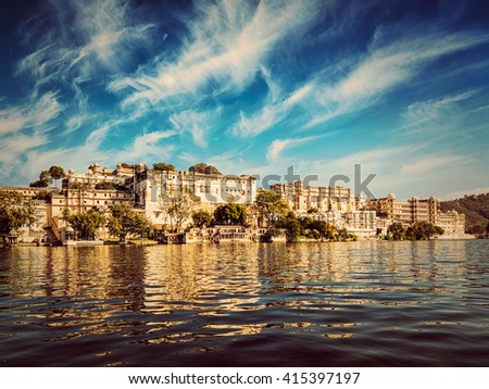 India luxury tourism concept background - vintage retro effect filtered hipster style image of Udaipur City Palace view from Lake Pichola. Udaipur, Rajasthan, India