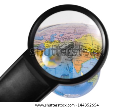 India on globe viewed through a magnifying glass - stock photo