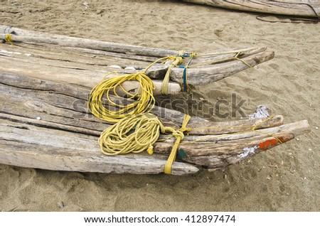 India, Puducherry, handmade crude boats on sand on the beach - stock photo