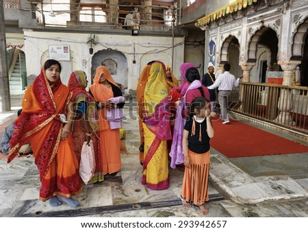 India, Rajasthan, Jaipur; 25 january 2007, indian people in a hindu temple near Sisodia Rani Ka Bagh Palace - EDITORIAL