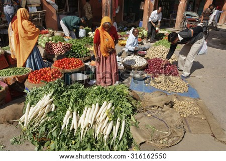 India, Rajasthan, Jaipur; 26 January 2007, indian people selling vegetables in a local market - EDITORIAL - stock photo
