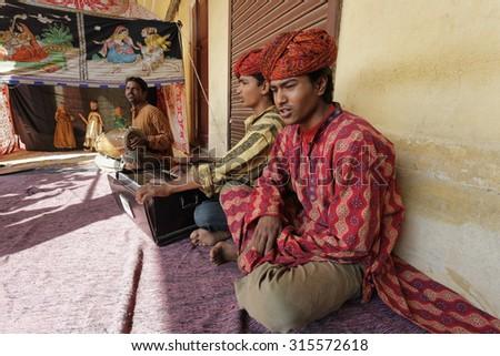 India, Rajasthan, Jaipur; 26 january 2007, local street players - EDITORIAL - stock photo