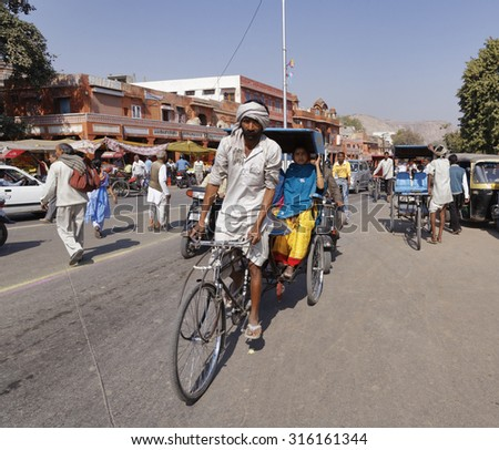 INDIA, Rajasthan, Jaipur; 26 january 2007, traffic in a central street of the city - EDITORIAL - stock photo