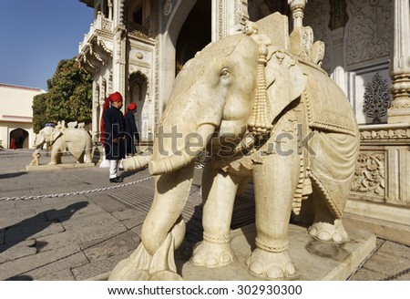India, Rajasthan, Jaipur; 26 yanuary 2007, imperial guards and marble elephants at the City Palace entrance - EDITORIAL - stock photo