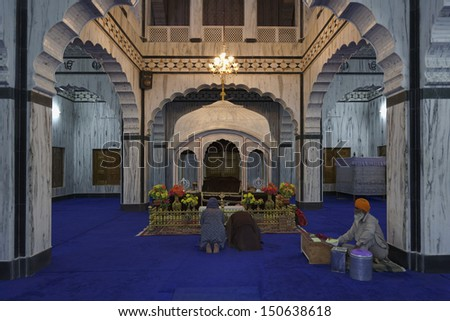 India, Rajasthan, Pushkar, indian people praying in an hindu temple - stock photo