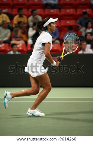 India's top tennis star, Sania Mirza, playing Olga Govortsova in the first round at Qatar Total Open, Doha, Feb 19, 2008. Mirza, a Muslim facing threats at home, retired with cramp in the third set.