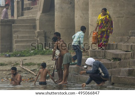 India - Varanasi - (27/02/2016). People taking their ritual morning bath in the Ganges near the ghats.