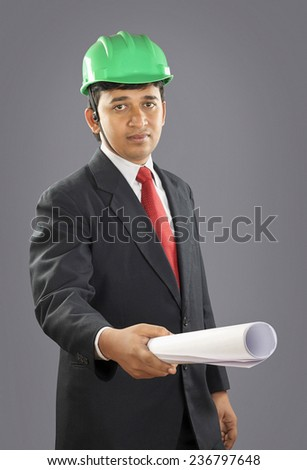 Indian architect with blue print - stock photo