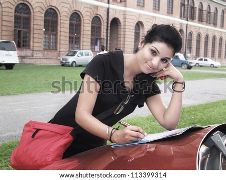 Indian / Asian college student studying in campus. - stock photo