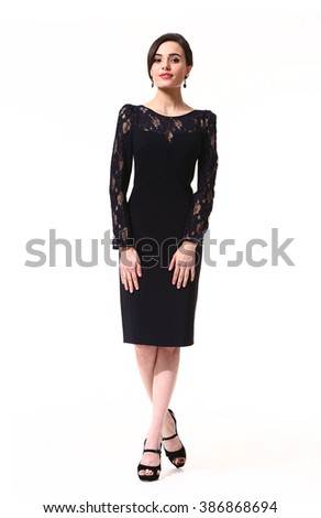 indian asian eastern brunette business executive woman with straight hair style in formal black cocktail party laces dress long sleeve dress high heel shoes standing full body length isolated on white - stock photo