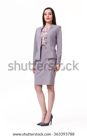 indian asian eastern brunette business executive woman with straight hair style in gray jacket skirt official suit high heels shoes full length body portrait standing isolated on white  - stock photo
