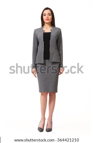 indian asian eastern brunette business executive woman with straight hair style in gray official two pieces suit jacket and skirt high heels shoes full length body portrait standing isolated on white - stock photo