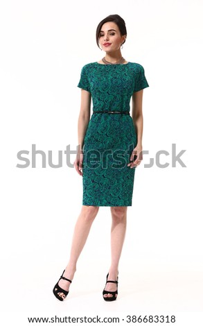 indian asian eastern brunette business executive woman with straight hair style in green emerald summer short sleeve dress high heel shoes standing full body length isolated on white