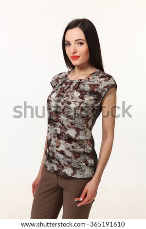 indian asian eastern brunette business executive woman with straight hair style in khaki military  t-shirt and trousers close up portrait isolated on white - stock photo