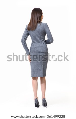 indian asian eastern brunette business executive woman with straight hair style in official jacket and skirt suit  high heels shoes full length body portrait standing isolated on white turn back - stock photo