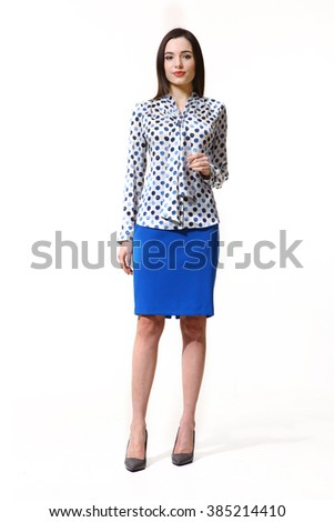 indian asian eastern brunette business executive woman with straight hair style in printed shirt  and blue skirt high heels shoes full length body portrait standing isolated on white - stock photo