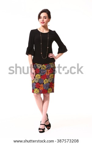 indian asian eastern brunette business executive woman with straight hair style in printed summer skirt and black blouse high heel shoes standing full body length isolated on white - stock photo