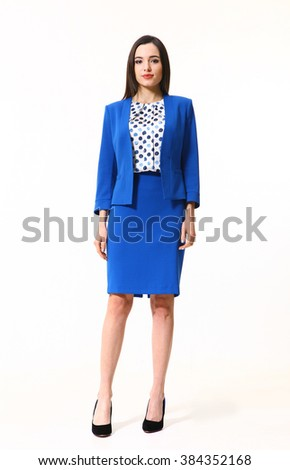 indian asian eastern brunette business executive woman with straight hair style in two pieces jacket and skirt blue suit high heels shoes full length body portrait standing isolated on white - stock photo