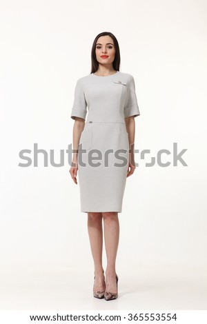 indian asian eastern brunette business executive woman with straight hair style in white short sleeve dress high heels shoes full length body portrait standing isolated on white - stock photo