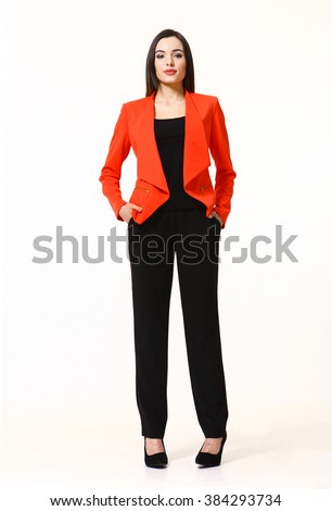 indian asian eastern brunette business executive woman with updo hair style in red jacket and black trousers high heels shoes full length body portrait standing isolated on white - stock photo