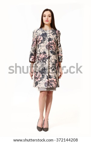 indian asian eastern brunette model student woman with straight hair style in floral printed trench coat high heels shoes full length body portrait standing isolated on white