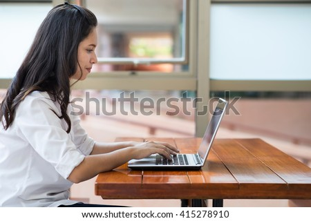 Indian,Asian girl student working and typing laptop computer. - stock photo