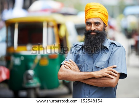 Indian auto rickshaw three-weeler tuk-tuk taxi driver man - stock photo