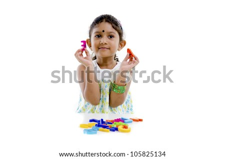 indian baby learning with alphabet blocks - stock photo