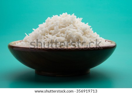 indian basmati rice, pakistani basmati rice, asian basmati rice, cooked basmati rice, cooked white rice, cooked plain rice in wooden bowl over plain colourful background
