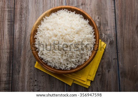 indian basmati rice, pakistani basmati rice, asian basmati rice, cooked basmati rice, cooked white rice, cooked plain rice in wooden bowl over brown wooden background
