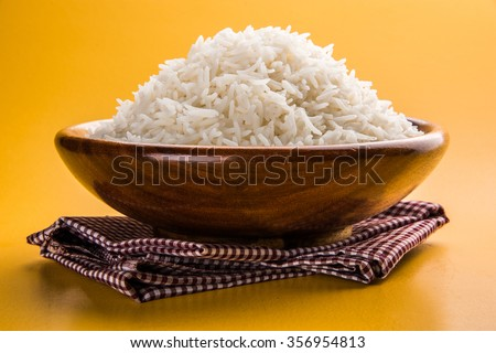 indian basmati rice, pakistani basmati rice, asian basmati rice, cooked basmati rice, cooked white rice, cooked plain rice in wooden bowl over yellow background