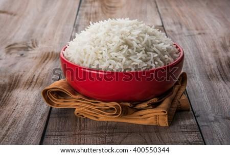 indian basmati rice, pakistani basmati rice, asian basmati rice, cooked basmati rice, cooked white rice, cooked plain rice in bowl over wooden background - stock photo