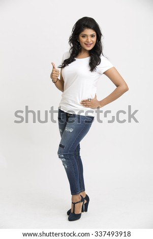Indian beautiful woman showing thumbs up on white background. - stock photo