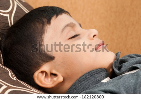 Indian boy sleeping closeup