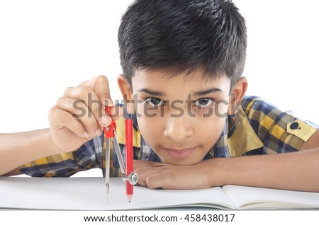 Indian boy with drawing compass