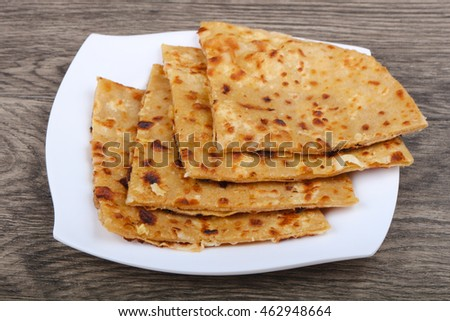 Indian bread roti on the plate in wood background
