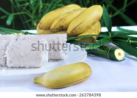 Indian breakfast puttu with banana - stock photo