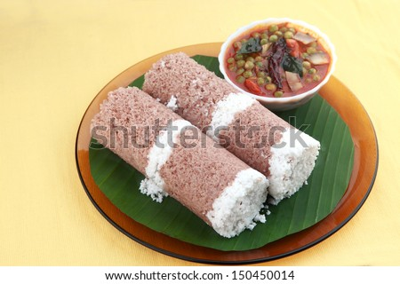 Indian breakfast Puttu with green peas curry. - stock photo