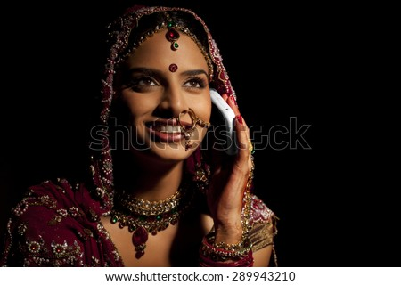 Indian bride talking on a mobile phone