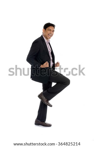 indian business male jumping in joy - stock photo