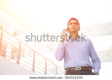 indian business male on a phone conversation outdoor - stock photo