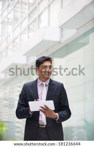 indian business male with a tablet - stock photo