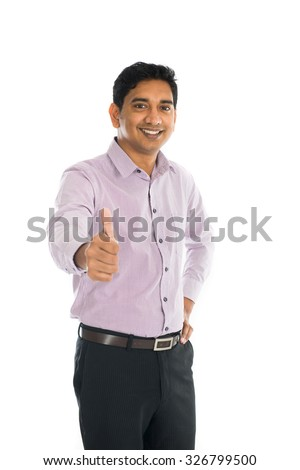 indian business male with thumbs up - stock photo