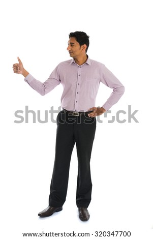 indian business male with thumbs up and smiling - stock photo