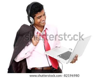 Indian business man hearing music isolated on white.