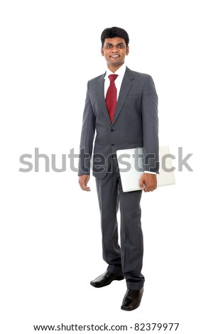 Indian business man standing with laptop isolated on white.