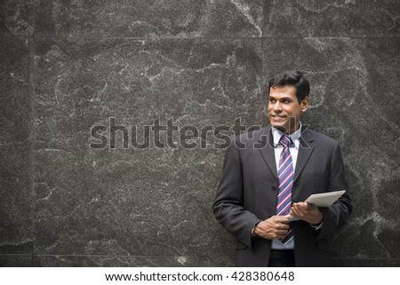 Indian business man with a tablet computer. Asian business man using digital tablet computer.